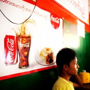 A Coca Cola advertisement in a tea shop in Yangon, Myanmar.